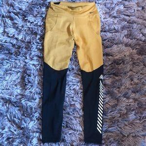 Nike gold leggings with mesh